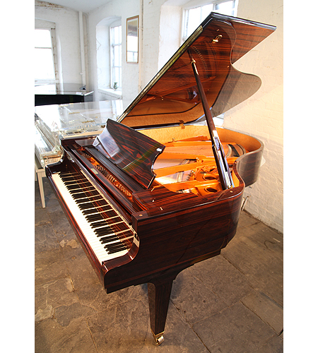 A Schimmel K189 grand piano with a macassar ebony case and a tapered, square legs