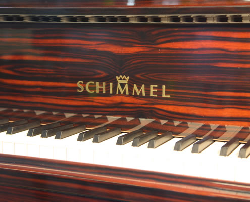 Schimmel K189  logo on fall. We are looking for Steinway pianos any age or condition.