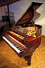 Piano for sale. A  Steinway Model A grand piano with a rosewood case.