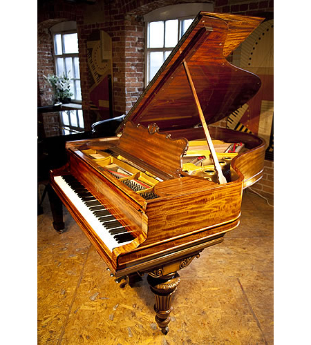 An 1898, Steinway Model A grand piano with a fiddleback mahogany case and turned, fluted legs with carved, acanthus detail