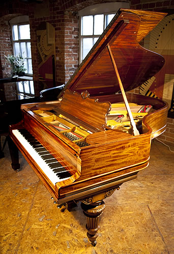 A 1978, Steinway & Sons Model O Grand Piano with a Fiddleback Mahogany Case and Turned, Fluted Legs