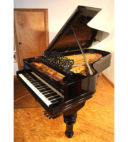 An 1882, Steinway Model C grand piano with a black case and turned, fluted legs. This piano belonged to Russian Princess Olga Romanov from the House of Holstein-Gottorp-Romanov