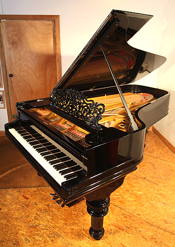 Steinway Model C Grand Piano For Sale with a Black Case and Turned, Fluted Legs. This piano belonged to Russian Princess Olga Romanov from the House of Holstein-Gottorp-Romanov