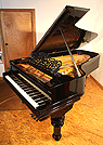 Piano for sale. An 1882, Steinway Model C grand piano with a black case.