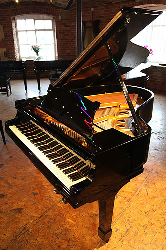 A 1923, Steinway Model O grand piano with a black case and spade legs