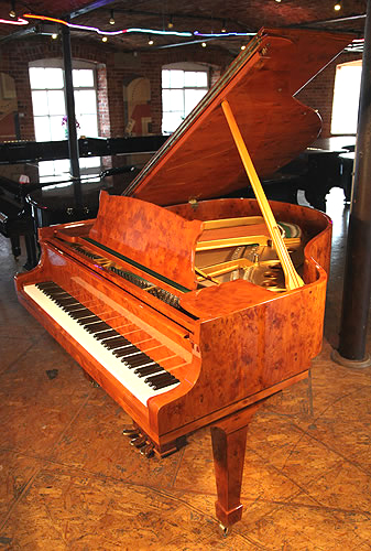 A stunning, Crown Jewels Steinway Model S baby grand piano with a yew case and spade legs.