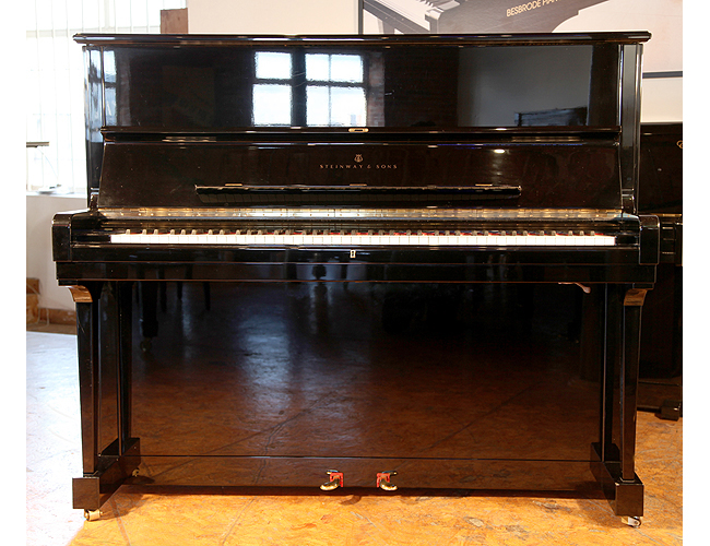 A 1987, Steinway Model V upright piano with a black case and mute practise lever