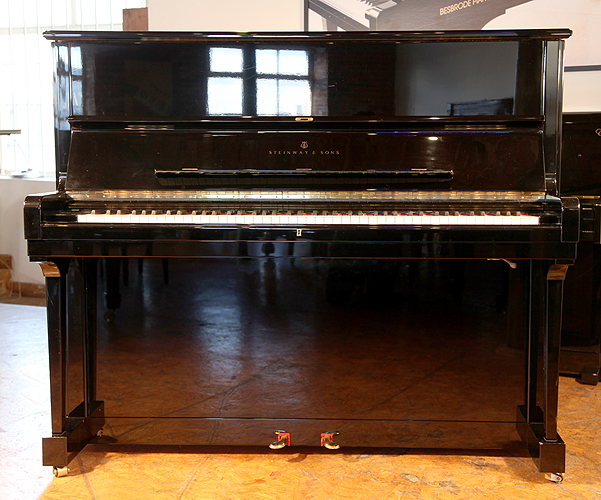 Steinway Model V upright Piano for sale with a black case.