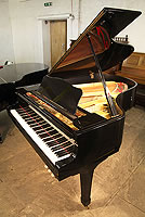 Yamaha G3 grand piano for sale with a black case