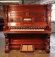 An 1890, Aeolian Harmonium with a Mahogany Case with Ornately Carved Pilasters and Fretwork Panels