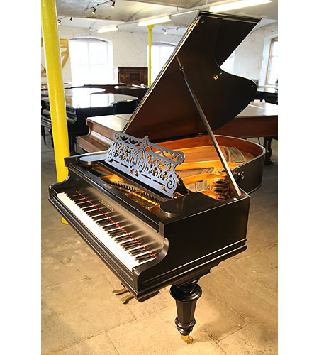A Bechstein Model A grand piano with a black, satin case and turned legs