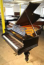 Piano A 1903, Bechstein Model A grand piano with a satin, black case and turned legs.
