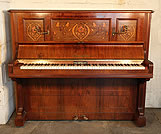 A 1912, Bechstein model III upright piano with a rosewood case and floral inlaid panels in an Art Nouveau style.