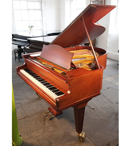 A Bechstein Model L grand piano with a mahogany case and dual casters