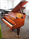 A 1959, Bechstein Model L grand piano with a mahogany case and dual casters
