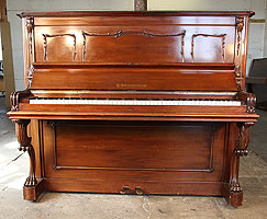 An 1890, Bechstein Model III upright piano with a walnut case and claw foot legs
