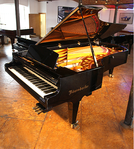 A 1974, Bosendorfer Model 290 Imperial grand piano with a polished, black case. This piano has 97 keys notably 8 extra bass notes