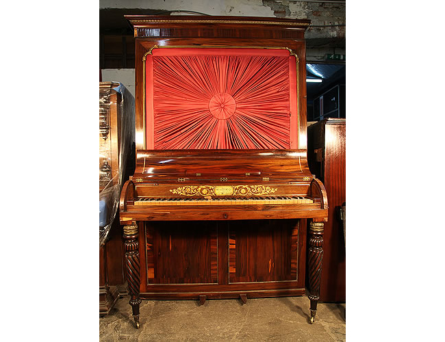 Clementi pianoforte with an inlaid, rosewood case and brass ormolu detail. Cabinet features pleated fabric panel
