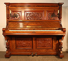 Emil Preikschat Upright Piano For Sale with an Ornately Carved, Classical Style Case.