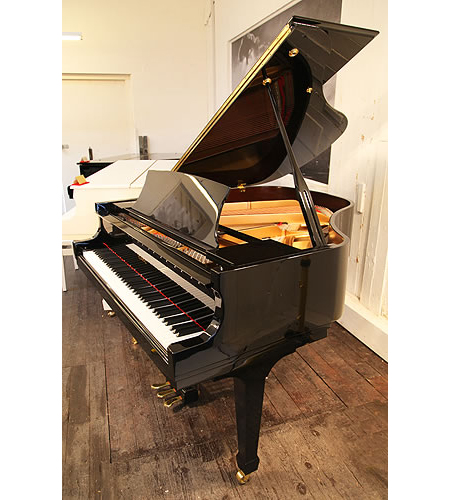 A secondhand, 2007, Essex EGP155 grand piano with a black case and polyester finish