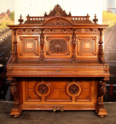 Oscar Gerbstadt upright piano for sale with an ornately carved, romanesque style case