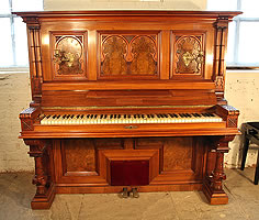 Schmidt Upright Piano For Sale with an Ornately Carved, Walnut Case.