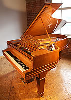 A 1900, Steinway Model B grand piano with a satinwood case with boxwood stringing detail.