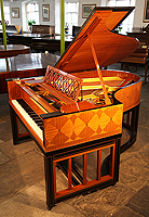An art cased Steinway Model O grand piano with a mahogany and ebony case. Inlaid with a trompe l'oeil effect in a geometric design