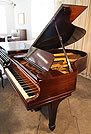An unrestored, 1907, Steinway Model O grand piano with a mahogany case and spade legs