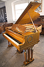 A 1919, Steinway Model O grand piano for sale with an Empire style mahogany case. Cabinet features ornate brass ormolu in Neoclassical and Egyptian motifs such as wreaths, winged lions and cabuchons. Legs feature cylindrical columns and female figures of victory on the capital