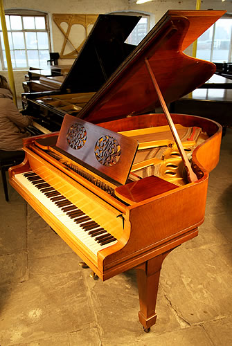 A 1921, Steinway & Sons Model O Grand Piano with a Walnut Case, Music Desk with Cut Outs in a Foliage Design  and Spade Legs