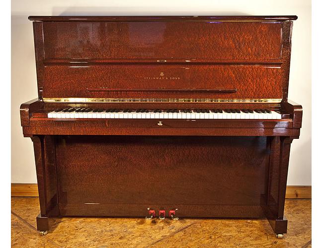 A 2003, Steinway Model V upright piano with a beautiful, sapele mahogany case