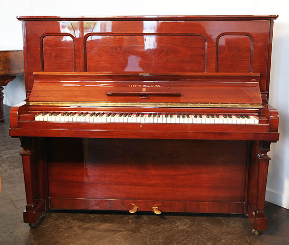 Steinway Model K upright Piano for sale with an black case.