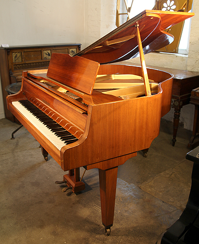 A 1987, Zimmermann Baby Grand Piano with a Walnut Case and Square, Tapereed Legs