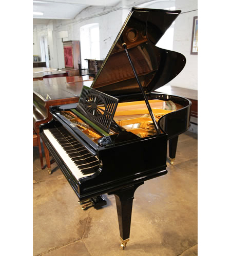 A restored, 1925, Bechstein Model A1 grand piano with a black case and square tapered legs