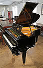 A 1925, Bechstein Model A1 grand piano with a black case and square tapered legs
