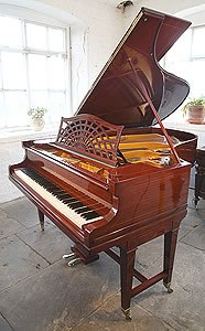 Bechstein Model B grand piano with a mahogany case.