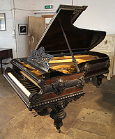 An 1883, Artcase, Bechstein Model C Grand Piano For Sale with a Pear and Ebony Case. Entire Cabinet Features Ornate Carvings of Female Figureheads, Lions and Arabesques