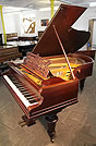 A Bechstein Model V grand piano with a rosewood case, filigree music desk and turned legs