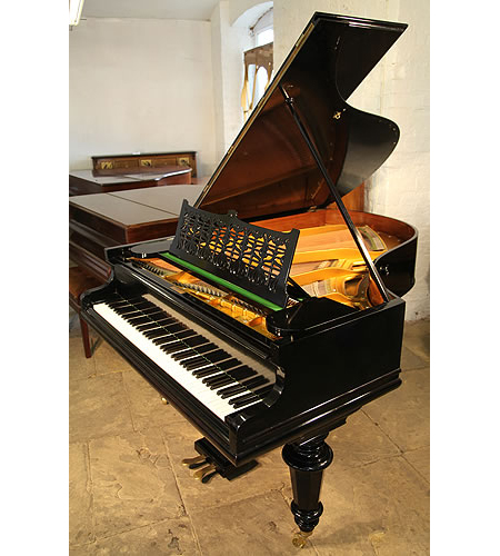 An antique, Bechstein Model VI grand piano with a black case and turned legs