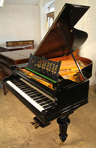 A Bechstein Model VI grand piano with a black case and turned legs