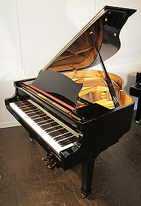 A Bluthner Baby Grand Piano For Sale with a Walnut Case and Spade Legs