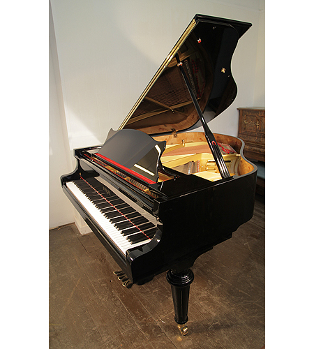A brand new, Besbrode Model 166 Professional grand piano with a black case and turned legs