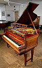 Piano for sale. A 1910, Bluthner grand piano with a Chippendale style mahogany case. Case designed by Waring and Gillow