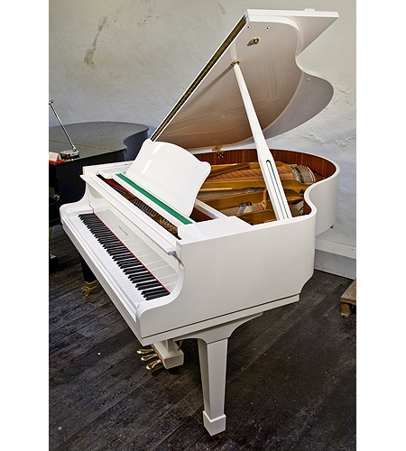 A Halle and Voight baby grand piano with a white case and polyester finish