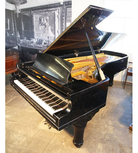 A 1949, Petrof model 1 concert grand piano with a black case. Beautiful tone with awesome power