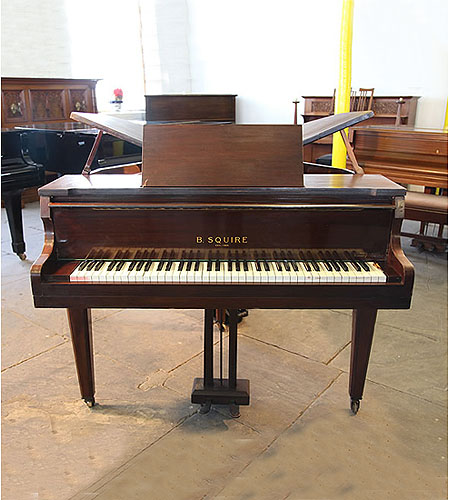A 1939, Squire butterfly baby grand piano with a mahogany case