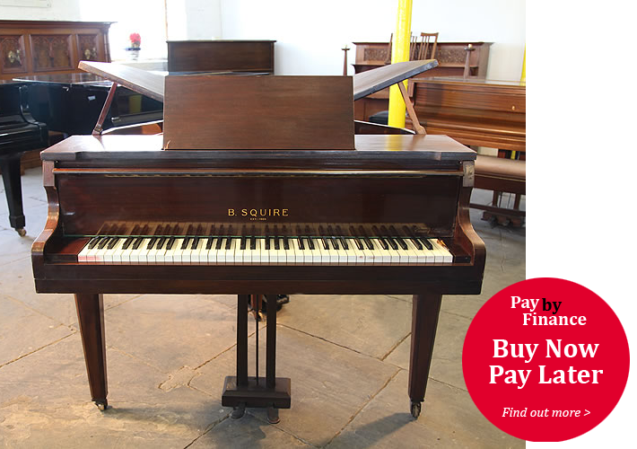 Squire Butterfly Baby  Grand Piano with a Mahogany Casee.