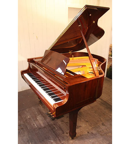 A brand new, Steinhoven GP160 baby grand piano with a mahogany case and polyester finish