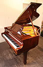 Piano for sale. A brand new Steinhoven GP160 grand piano with a walnut case and polyester finish.
